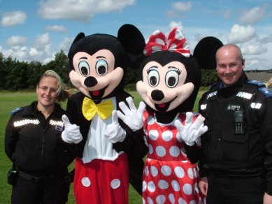 Mickey and Minnie Mouse join forces with officers from the South Moor Neighbourhood Police Team during the  recent Family Fun Day