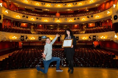 Panto star and relaxed performance performer Danny Adams helps celebrate with Director of Operations Dawn Taylor.