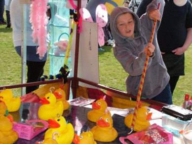Having fun trying to hook a duck for a prize at the Family Fun Day
