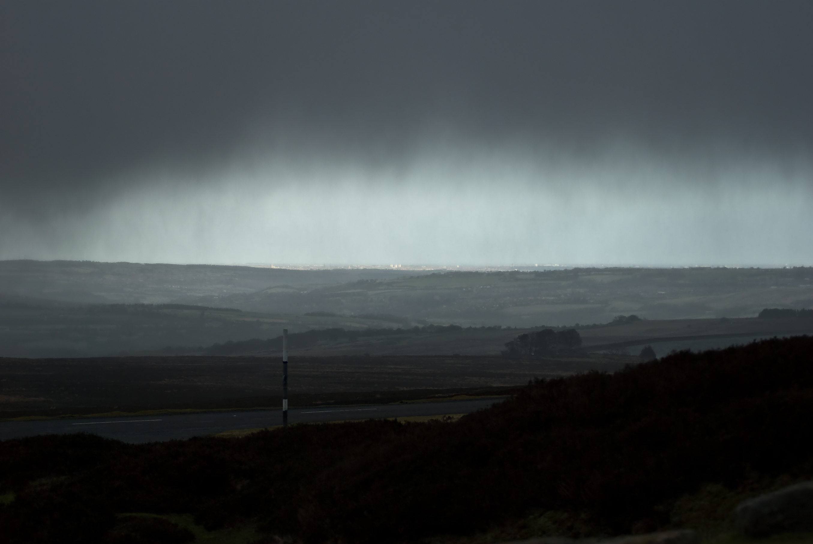 Courtesy of Jonathan Pearson - Rain over the moors, sun over Consett - Creative Commons Flickr