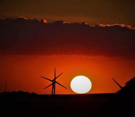 Sunset over Consett with Wind Turbines