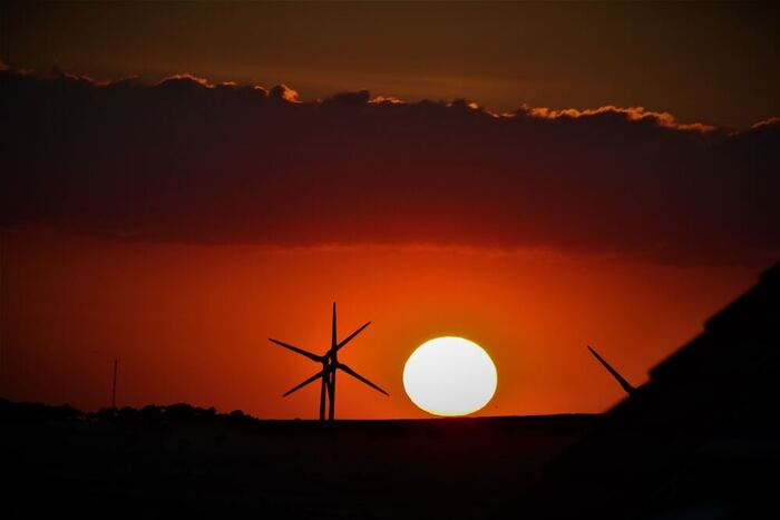 Sunset over Consett with Wind Turbines