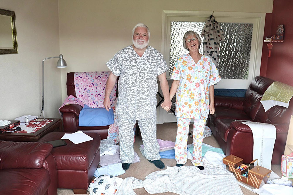 Consett Coronavirus 2. PPE makers. - Marj Stephenson, and her husband Jim, answered calls to make PPE in the first lockdown including face coverings and scrubs. The couple used an array of old fabrics and can be seen modelling their handmade scrubs before delivering them to University Hospital Durham for NHS staff.