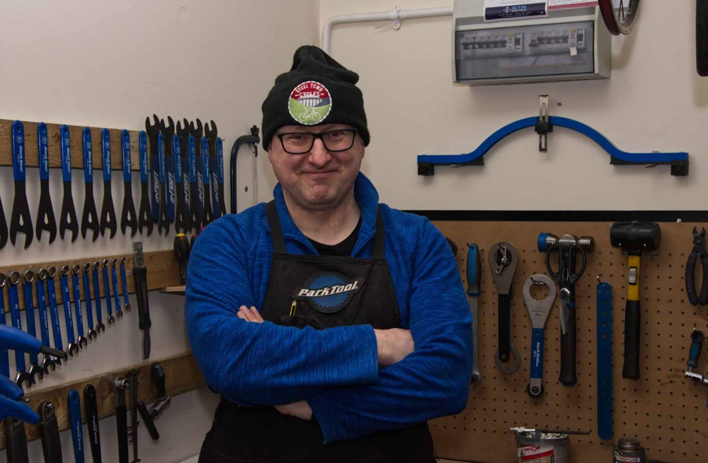 3. Keeping the people peddling. Jonathan from Steeltown Cycles was very busy during the first Lockdown, when people went to get their bikes out of the garage or the shed to do their daily exercise, only to find they needed quite a lot of attention. (Image: Chris Bruce)